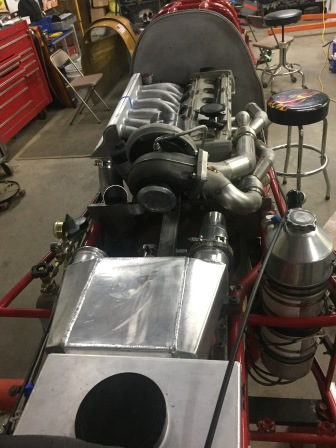 Header and intake from rear
